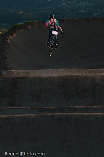 BMX racer jumping