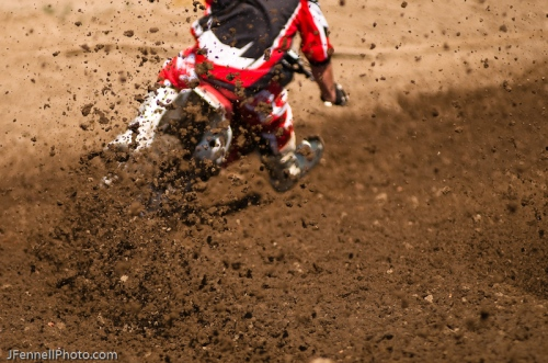 Photo of Motocross racing through a berm