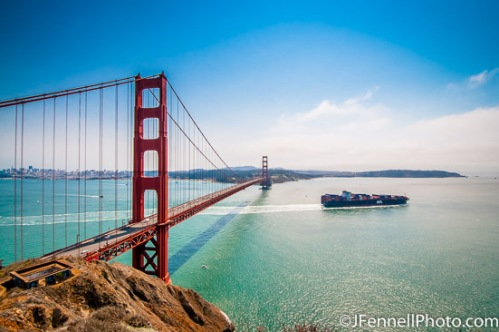 Big Cargo Ship passing the Golden Gate Bridge on it's way out to sea.